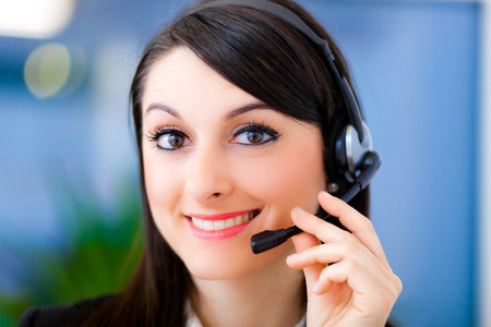 Portrait of a beautiful customer representative at work Stock Photo