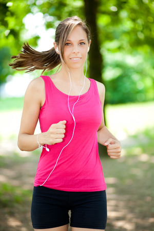 spandex: Active woman doing fitness at the park Stock Photo