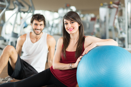 Portrait of a smiling couple in a gym photo