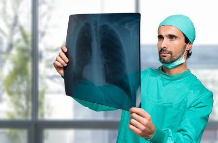Portrait of a doctor looking at a radiography Stock Photo