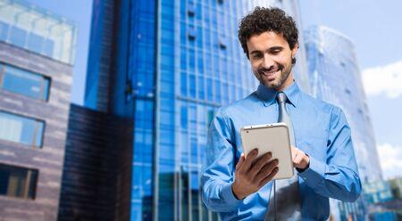Handsome businessman using a digital tablet Фото со стока
