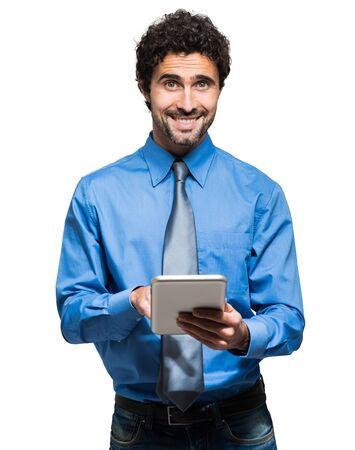 Portrait of a young business man holding his tablet Фото со стока