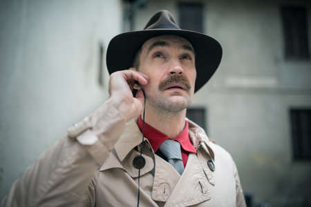 Detective listening from his ear buds