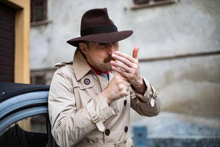 Vintage detective tuxedo at cigarette ina city slum