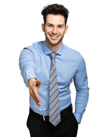 Young manager giving you a handshake Stock Photo