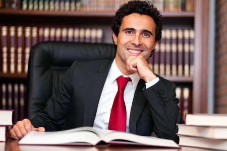 Lawyer portrait in his studio Foto de archivo