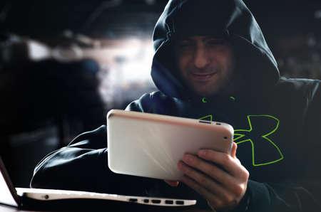 Hacker hacking a digital tablet