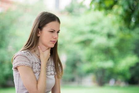 Young woman having sore throat