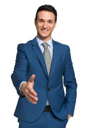 Young businessman giving an handshake, isolated on white Stock Photo
