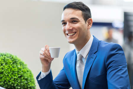 Portrait of a businessman drinking coffee Stockfoto