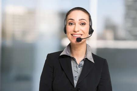 Customer service concept, businesswoman talking to a customer using an headset Foto de archivo