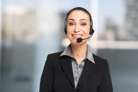 Customer service concept, businesswoman talking to a customer using an headset Imagens