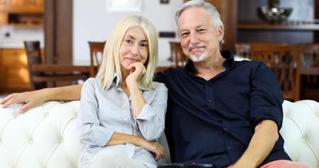 Portrait of an happy mature couple in their home Stockfoto