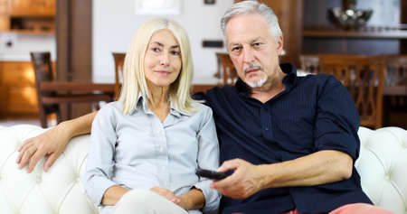 Portrait of an happy mature couple in their home