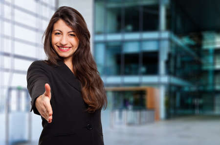 Young female manager giving you a handshake Stock Photo