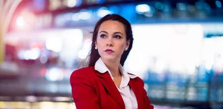 Business woman portrait at night, illuminated background 免版税图像