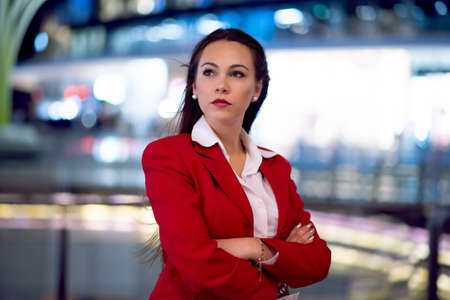 Portrait of a young business woman waiting outdoors in a city at night time 免版税图像
