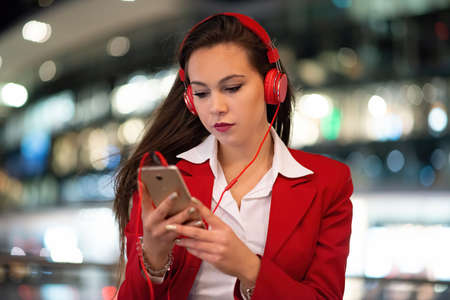 Woman listening music from her mobile phone