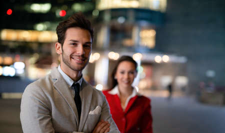 Portrait of young business people at night, businessman and businesswoman together 免版税图像