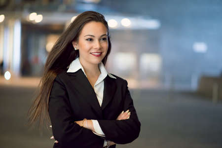 Business woman smiling, night