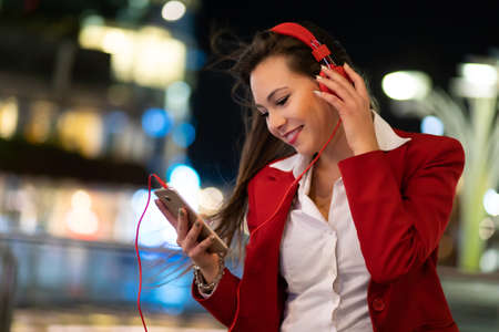 Woman listening music from her cellphone