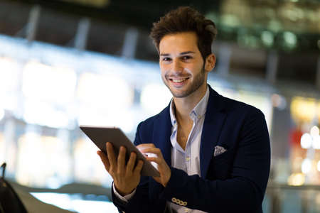 Young manager using a digital tablet outdoor