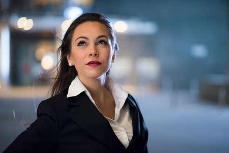 Business woman portrait at night