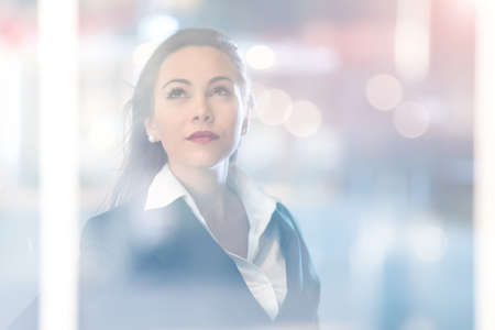 Portrait of a young business woman, double exposure effect. Businesswoman career