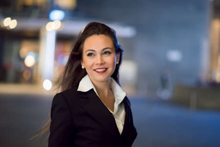 Young business woman portrait at night in a city