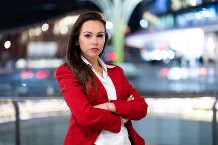 Young businesswoman portrait in a modern city setting at night 免版税图像