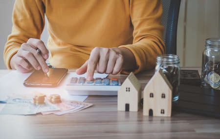 Image Young asian woman using smartphone calculator calculate loan in home, concept finance business investment property. selective focus Stock Photo