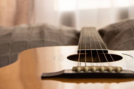 Guitar close-up view. Overexposed background. Selective focus. Copy Space. Grain.