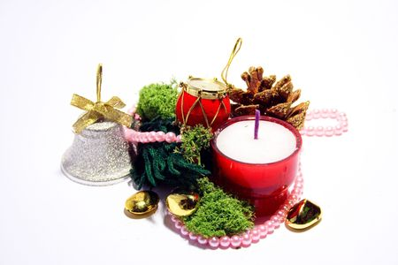 Christmas composition - cones, jungle bells,noss and candle