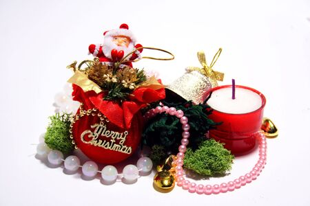 Christmas composition - cones, jungle bells,noss and candle photo