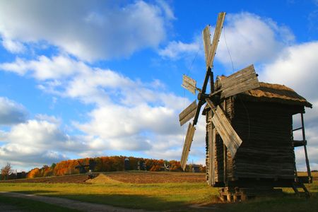 Windmill over meadow , Autumn Landscape, beautiful vivid nature Stock Photo