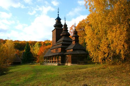 Ancient rural church in the autumn landscape Stock Photo