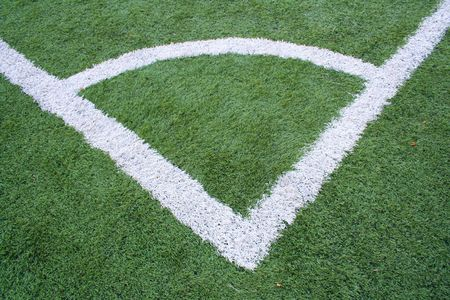 artifical: Cormer. Football field with the artifical grass