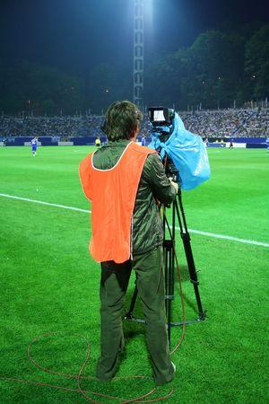 Cameraman, operator on the stadium Stock Photo