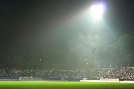 After the battle. On the stadium. Light in the puff of smoke; Stock Photo