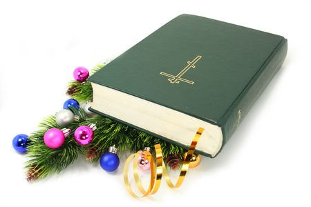 Bible with bookmark on the christmas decorations over the white photo