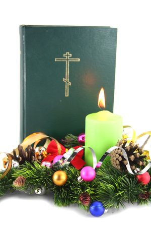 pere noel: Holy bible on christmas with the conier and candle