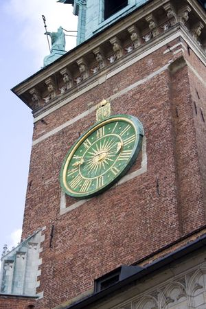 Clock on the Chapel in Wawel Castle. Krakow. Poland. Medieval history memorial Stock Photo - 2737418