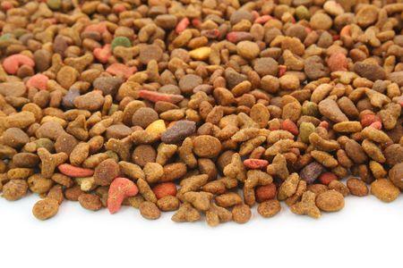 Food du PET (chats, chiens, etc.) sur le fond blanc