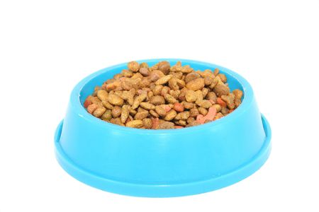 Pets food (cat, dog, etc.) in the bowl; isolated over whte Stock Photo