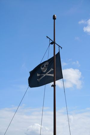 jolly roger (joli rouge) - pirate flag on the mast Stock Photo - 2779120