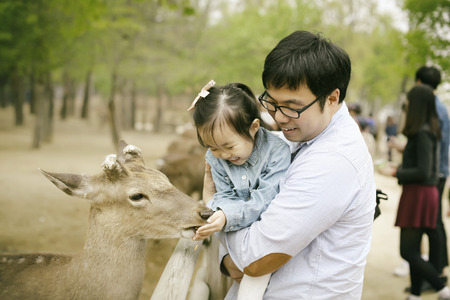 feed: Dad and daughter in park Stock Photo