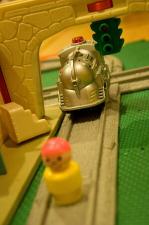 A small character is on the train track.