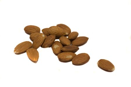 shelled: A Hanfull of almonds isolated on white. Stock Photo