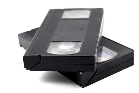 vhs videotape: Two video casettes isolated on white.