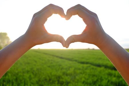jesus hands: Heart symbol Stock Photo